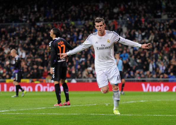 MADRID, SPAIN - NOVEMBER 30:  Gareth Bale of Real Madrid CF celebrates after scoring Real's opening goal during the La Liga match between Real Madrid CF and Real Valladolid CF at Santiago Bernabeu stadium on November 30, 2013 in Madrid, Spain.  (Photo by Denis Doyle/Getty Images)